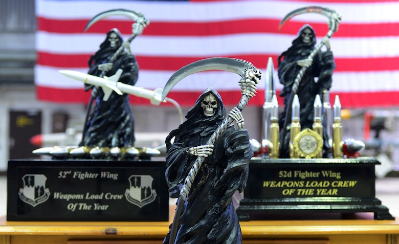 Weapons Load Crew of the Year trophies await the winner of the weapons load competition in Hangar 1 at Spangdahlem Air Base, Germany, Jan. 9, 2015. The winners of the competition will be announced later this month at an awards ceremony. (U.S. Air Force photo by Airman 1st Class Luke Kitterman/Released)