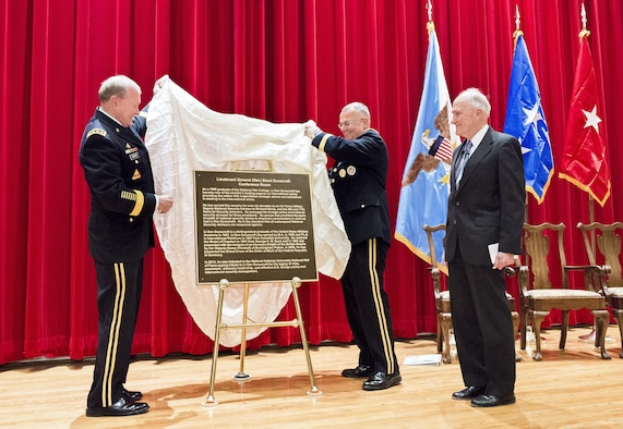 Army Gen. Martin E. Dempsey, left, and Army Brig. Gen. Guy Cosentino unveil a door placard to honor retired Air Force Lt. Gen. Brent Scowcroft during a dedication ceremony for Scowcroft Jan. 13, 2015, at the National Defense University's National War College on Fort Lesley J. McNair in Washington, D.C. The university hosted the event to officially dedicate a Roosevelt Hall room to Scowcroft, a former national security advisor. Dempsey is the chairman of the Joint Chiefs of Staff and Cosentino is the National War College commandant. (DOD photo/Army Staff Sgt. Sean K. Harp)