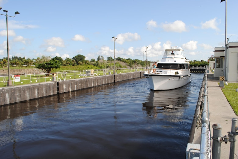 A boat navigates through the St. Lucie Lock & Dam near Stuart.  The U.S. Army Corps of Engineers is taking comments on a proposal to reduce operating hours of the St. Lucie Lock and four others on the Okeechobee Waterway.