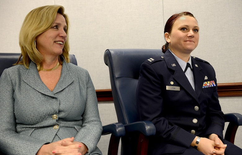 Secretary of the Air Force Deborah Lee James sits with Capt. Dana Lyon during the naming ceremony of the Motor Vessel Capt. David I. Lyon, Jan. 14, 2015, in the Pentagon.  The vessel was named in honor of Capt. David Lyon, who was killed in action Dec. 27, 2013, while serving in support of Operation Enduring Freedom.  (U.S. Air Force photo/Scott M. Ash)