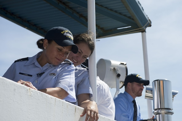 Capt. Dana M. Lyon, widow of Capt. David I. Lyon, and 2nd Lt. Alana Piccone look down at the water surrounding the Motor Vessel Capt. David I. Lyon, Aug. 11, 2014, at Military Ocean Terminal Sunny Point in Southport, N.C. The MV Capt. David I. Lyon is an Air Force prepositioning vessel named in honor of Capt. David I. Lyon, an Air Force logistics readiness officer and 2008 U.S. Air Force Academy graduate who was killed in action Dec. 27, 2013, in Afghanistan. The vessel will transport critical war reserve materiel to locations around the globe. (U.S. Air Force photo/Tech. Sgt. Jason Robertson)