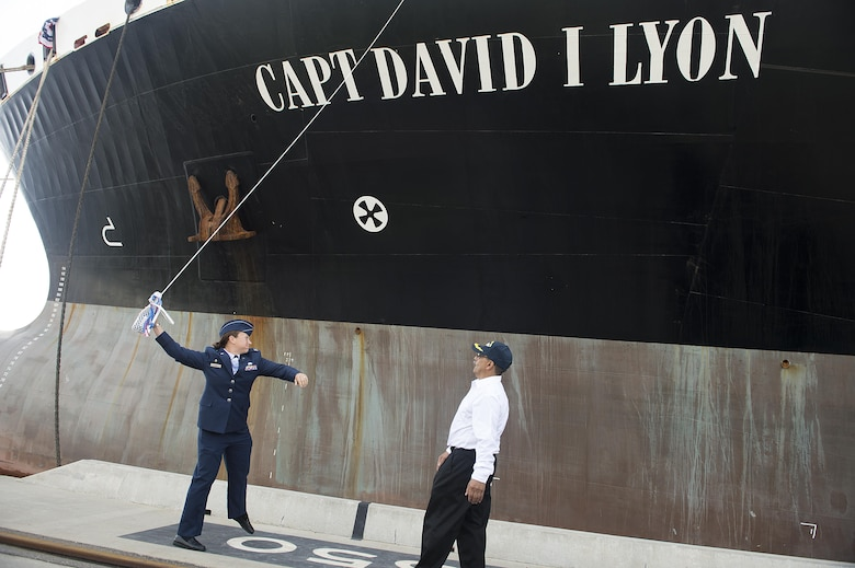 Capt. Dana M. Lyon, widow of Capt. David I. Lyon, prepares to break a champagne bottle on the hull of the Motor Vessel Capt. David I. Lyon during a christening and ship visit, Aug. 11, 2014, at Military Ocean Terminal Sunny Point, Southport, N.C. The MV Capt. David I. Lyon is an Air Force prepositioning vessel named in honor of Capt. David I. Lyon, an Air Force logistics readiness officer and 2008 U.S. Air Force Academy graduate who was killed in action Dec. 27, 2013, in Afghanistan. The vessel will transport critical war reserve materiel to locations around the globe. (U.S. Air Force photo/Tech. Sgt. Jason Robertson)