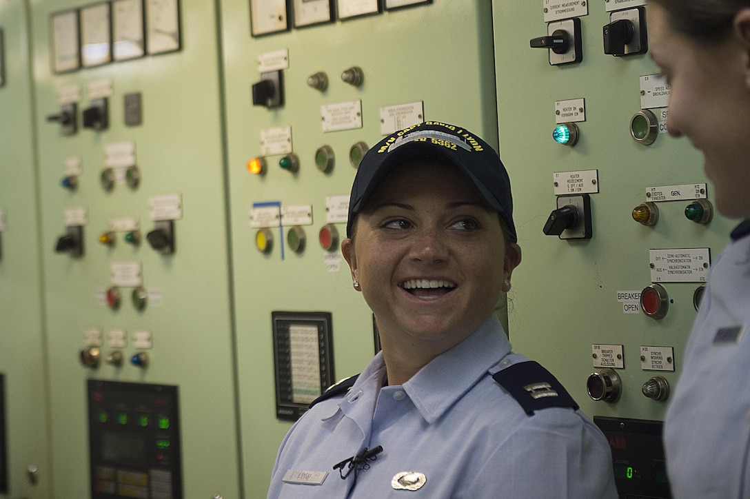 Capt. Dana M. Lyon, widow of Capt. David I. Lyon, talks with 2nd Lt. Alana Piccone during a tour of the Motor Vessel Capt. David I. Lyon, Aug. 11, 2014, at Military Ocean Terminal Sunny Point in Southport, N.C. The MV Capt. David I. Lyon is an Air Force prepositioning vessel named in honor of Capt. David I. Lyon, an Air Force logistics readiness officer and 2008 U.S. Air Force Academy graduate who was killed in action Dec. 27, 2013, in Afghanistan. The vessel will transport critical war reserve materiel to locations around the globe. (U.S. Air Force photo/Tech. Sgt. Jason Robertson)