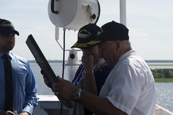 Capt. David I. Lyon's parents, Jeannie and Robert Lyon, look over a photograph given to them by the crew of the Motor Vessel Capt. David I. Lyon, Aug. 11, 2014, at Military Ocean Terminal Sunny Point in Southport, N.C. The MV Capt. David I. Lyon is an Air Force prepositioning vessel named in honor of Capt. David I. Lyon, an Air Force logistics readiness officer and 2008 U.S. Air Force Academy graduate who was killed in action Dec. 27, 2013, in Afghanistan. The vessel will transport critical war reserve materiel to locations around the globe. (U.S. Air Force photo/Tech. Sgt. Jason Robertson)