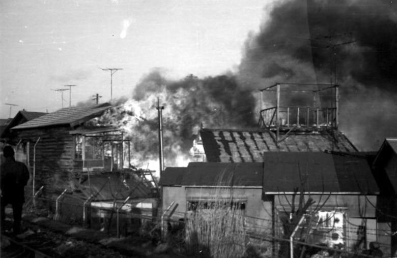 Fire destroys a Japanese bar just outside of the Misawa Air Base perimeter on January 11, 1966.