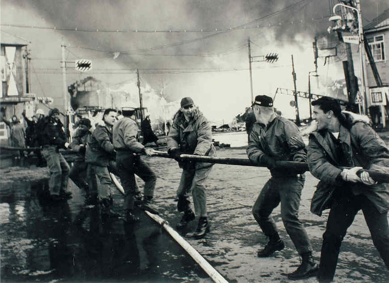 Misawa Airmen respond to a major fire in Misawa City on January 11, 1966.
