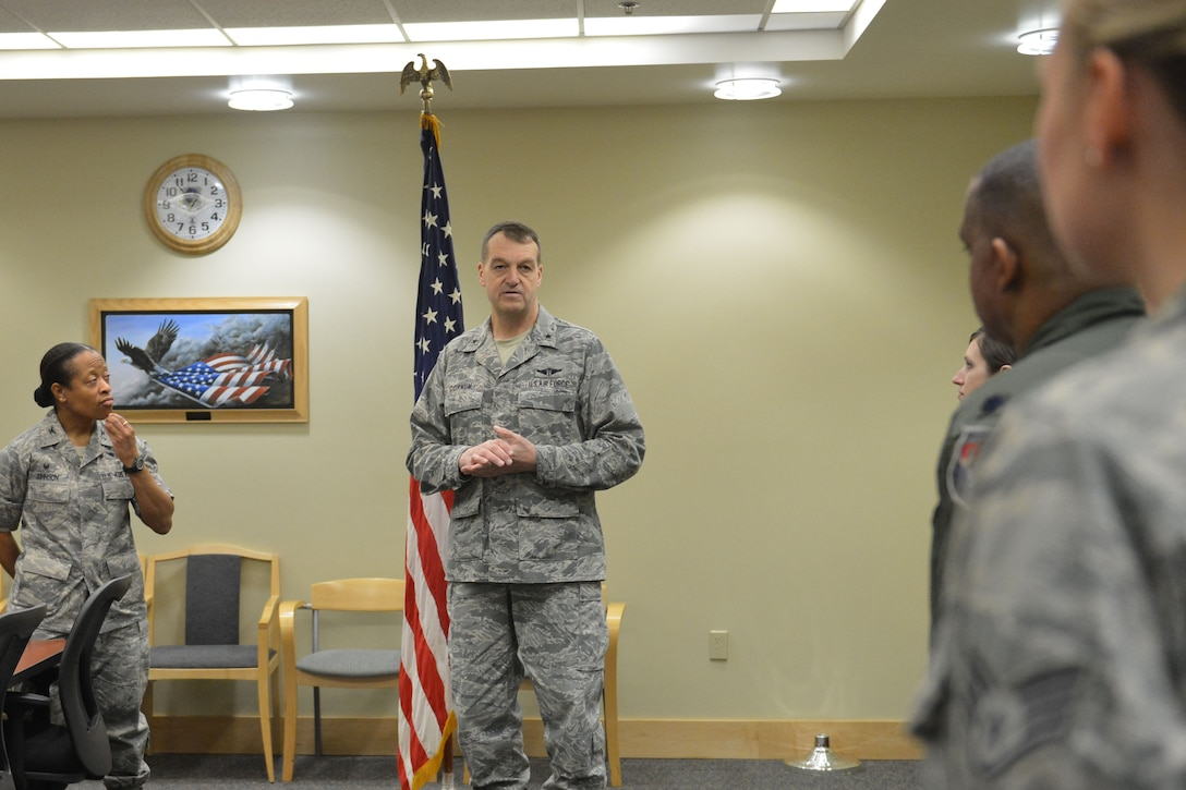 Brig. Gen. Kory Cornum (center), Air Mobility Command surgeon general, speaks with members of the 62nd Medical Squadron Jan. 14, 2015, at Joint Base Lewis-McChord, Wash. Airmen of the 62nd MDS distinguished themselves by winning two 2014 AMC awards for the Personnel Reliability Program on an individual and team basis. (U.S. Air Force photo/Senior Airman Rebecca Blossom)