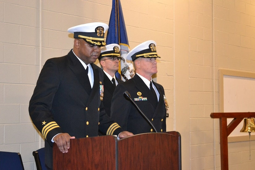 Commander Stephen Jones (left) assumed command of Navy Operational Support Center from CDR Shaun Murphy (right), Jan. 10, 2015 at Joint Base Charleston - Weapons Station. Jones' previous assignment was at U.S. Special Operations Command, MacDill Air Force Base, Fla., and Jones will become the deputy director of Legislative Affairs with the Chief of Navy Reserve at the Pentagon, D.C. (Courtesy Photo)