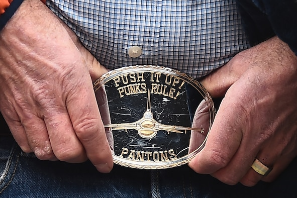 "A belt buckle worn by William ""Ham"" DuBois, the father of Capt. William H. DuBois, is a memento to his son who lost his life in an F-16 Fighting Falcon accident while on deployment. The family of DuBois was presented the game ball before the Denver Broncos playoff game to honor his service and sacrifice.  (U.S. Air Force photo by Airman 1st Class Luke W. Nowakowski/Released)"