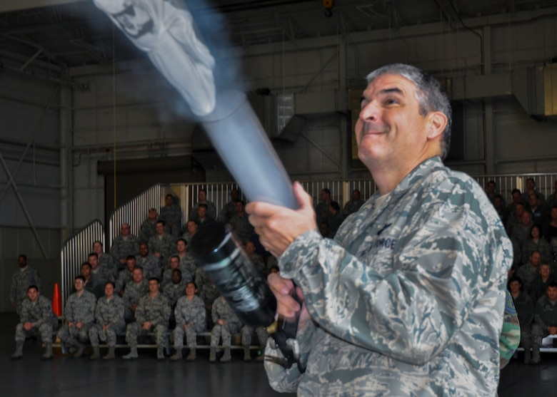 Col. Jim Phillips, the 919th Special Operations Wing commander, launches a t-shirt into the crowd with a cannon to promote the wing's March 7 combat dining-in event Jan. 11 at Duke Field, Fla.  To purchase tickets, contact any 919th SOW chief master sergeant to purchase tickets. (U.S. Air Force photo/Dan Neely)