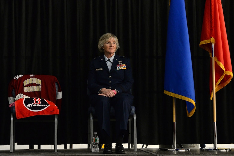 "Brig. Gen. Carolyn J. Protzmann, N.H. Air National Guard commander, sits beside a chair with items representative of Lt. Col. Stephanie Riley during a posthumous retirement ceremony in her honor in Hangar 254, Jan. 10. Among the items placed in the chair were a Boston College jersey, Boston Red Sox hat and towel representing 'Boston Strong,"" a similar moniker that her supporters adopted as their own. (U.S. Air National Guard photo by Tech. Sgt. Mark Wyatt)"