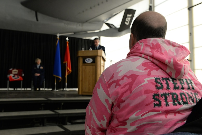 Shawn Riley, husband of Lt. Col. Stephanie Riley who passed away Dec. 29 at the age of 47, sits in the front row wearing a 'Steph Strong' sweatshirt during a posthumous retirement ceremony for his wife in Hangar 254, Jan. 10. Riley, a N.H. National Guard occupational health nurse, became an advocate after her diagnosis she for people to take the signs your body is showing more seriously.  (U.S. Air National Guard photo by Tech. Sgt. Mark Wyatt)
