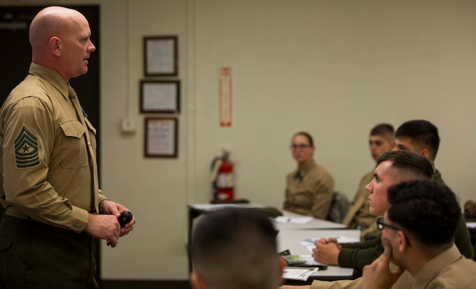 Sgt. Maj. Derek Fry, the Marine Aircraft Group 13 sergeant major and Lance Corporal Leadership and Ethics Seminar director, briefs an audience of Marines on the history of MAG-13 aboard Marine Corps Air Station Yuma, Ariz., Monday, Jan. 12, 2015. The seminar provided an opportunity to enhance the Marines' leadership development through small group discussions with course instructors.