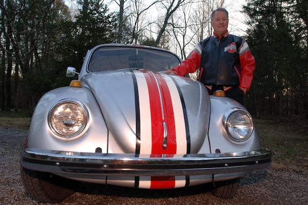 "Jeff Linkinhoker, project manager in the U.S. Army Corps of Engineers Nashville District, poses Jan. 14, 2015 with his 1968 vintage Volkswagen Beetle that he restored in 2011 and painted to look like an Ohio State University football helmet.  A huge Buckeyes fan, he was featured Jan. 8, 2015 by ABC Channel 6 from Columbus, Ohio in their ""Drive to the Championship"" report as they passed through Nashville, Tenn., on their way to college football's national championship game."