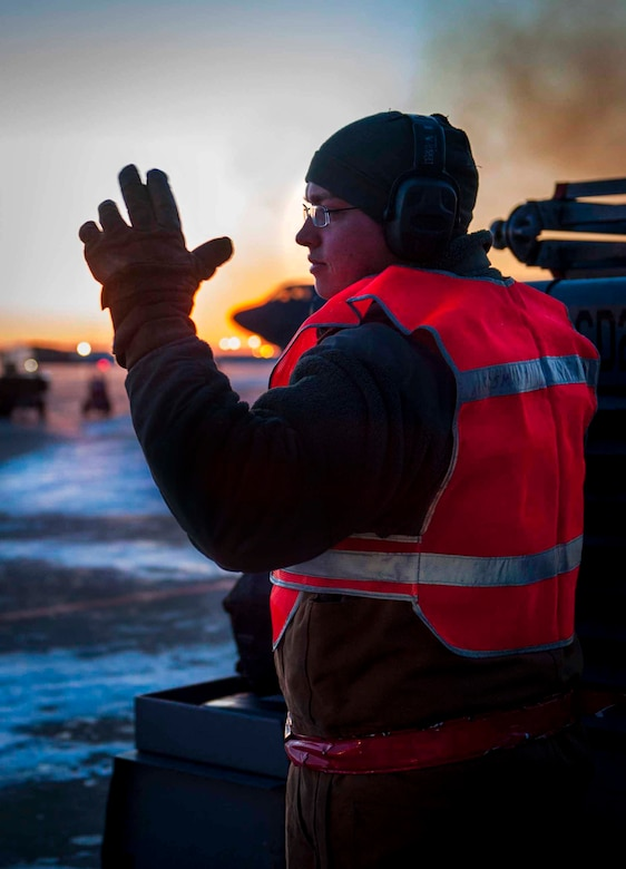 Senior Airman Taylor Lancaster guides a truck to a trailer Jan. 9, 2014 on Minot Air Force Base, N.D. The truck was hitched to a trailer that holds all of the tools the Airmen need for the jet to transport to other jets as needed. Lancaster is a 5th Aircraft Maintenance Squadron aircraft crew chief. (U.S. Air Force photo/Airman 1st Class Sahara L. Fales)