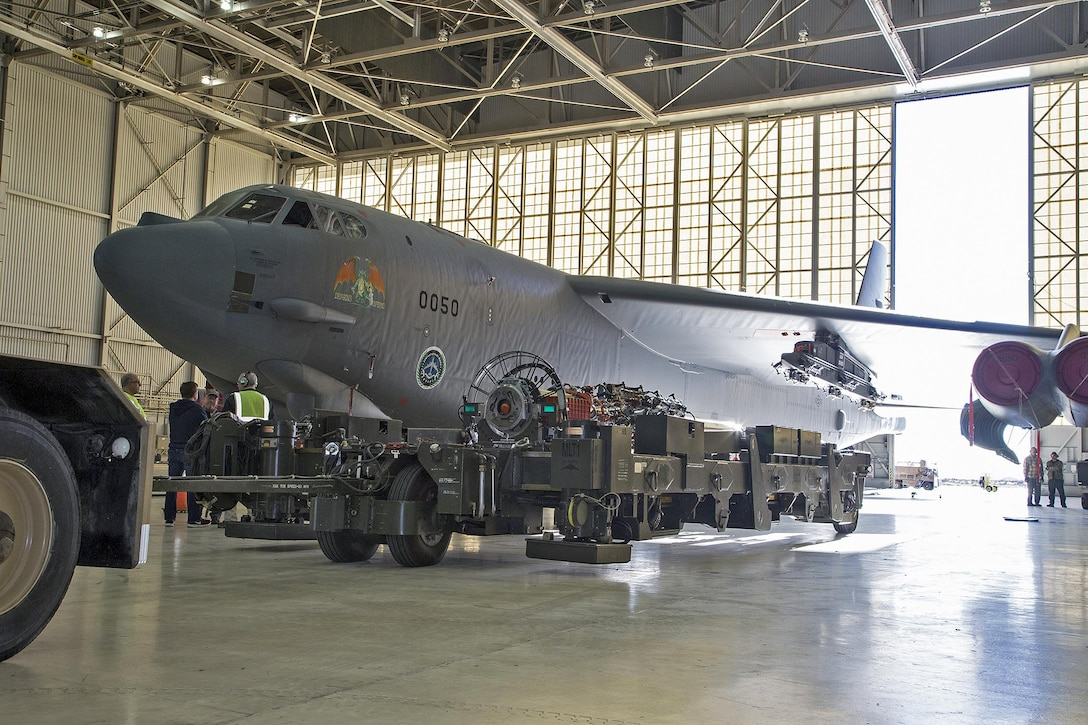 "Team members from the 419th Flight Test Squadron, the Global Power Bomber Combined Test Force and Boeing installed a Conventional Rotary Launcher (CRL) December 2014, on a B-52H Stratofortress from Edwards Air Force Base, Calif. The upgrade modifies the internal weapons bay of the B-52H by integrating a CRL that has the capability of carrying Military Standard 1760 ""smart weapons."" (U.S. Air Force photo/Bobbi Zapka)"