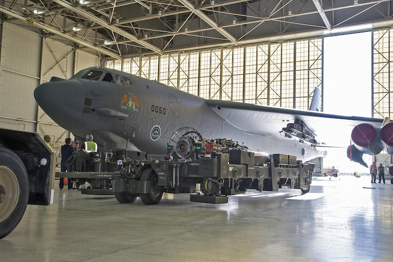 """Team members from the 419th Flight Test Squadron, the Global Power Bomber Combined Test Force and Boeing installed a Conventional Rotary Launcher (CRL) December 2014, on a B-52H Stratofortress from Edwards Air Force Base, Calif. The upgrade modifies the internal weapons bay of the B-52H by integrating a CRL that has the capability of carrying Military Standard 1760 """"smart weapons."""" (U.S. Air Force photo/Bobbi Zapka)"""