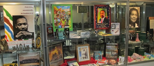 """The theme for the 2015 Dr. Martin L. King Jr celebration is """"Remember! Celebrate!  Act! A Day on Not a Day Off! Huntsville Center employees provided artifacts for a display to honor Dr. King's legacy and highlight the community service projects Center employees participate in across our nation."""