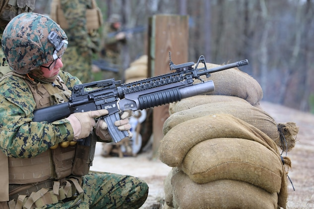 Cpl. Sierra K. Tilson, rifleman with 3rd Platoon, Company A, Ground Combat Element Integrated Task Force, fires the M203 grenade launcher during a live-fire range at the Verona Loop training area, near Marine Corps Base Camp Lejeune, North Carolina,  Jan. 14, 2015. Marines with Co. A conducted live-fire training, squad attacks, and patrolling in preparation for their upcoming assessment at Marine Corps Air Ground Combat Center Twentynine Palms, California. From October 2014 to July 2015, the GCEITF will conduct individual and collective level skills training in designated ground combat arms occupational specialties in order to facilitate the standards based assessment of the physical performance of Marines in a simulated operating environment performing specific ground combat arms tasks. (U.S. Marine Corps photo by Sgt. Alicia R. Leaders/Released)