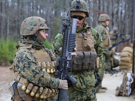 Sgt. Radmila M. Allen, left, team leader with 3rd Platoon, Company A, Ground Combat Element Integrated Task Force, talks with Sgt. Jesus Garcia, squad leader with 3rd Plt., Co. A, GCEITF, and position safety officer, about the course of fire for the M203 live-fire at the Verona Loop training area, near Marine Corps Base Camp Lejeune, North Carolina, Jan. 14, 2015. Marines with Co. A conducted live-fire training, squad attacks, and patrolling in preparation for their upcoming assessment at Marine Corps Air Ground Combat Center Twentynine Palms, California. From October 2014 to July 2015, the GCEITF will conduct individual and collective level skills training in designated ground combat arms occupational specialties in order to facilitate the standards based assessment of the physical performance of Marines in a simulated operating environment performing specific ground combat arms tasks. (U.S. Marine Corps photo by Sgt. Alicia R. Leaders/Released)