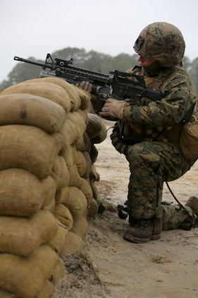 Sgt. Radmila M. Allen, team leader with 3rd Platoon, Company A, Ground Combat Element Integrated Task Force, fires the M203 grenade launcher during a live-fire range at the Verona Loop training area, near Marine Corps Base Camp Lejeune, North Carolina, Jan. 14, 2015. Marines with Co. A conducted live-fire training, squad attacks, and patrolling in preparation for their upcoming assessment at Marine Corps Air Ground Combat Center Twentynine Palms, California. From October 2014 to July 2015, the GCEITF will conduct individual and collective level skills training in designated ground combat arms occupational specialties in order to facilitate the standards based assessment of the physical performance of Marines in a simulated operating environment performing specific ground combat arms tasks. (U.S. Marine Corps photo by Sgt. Alicia R. Leaders/Released)
