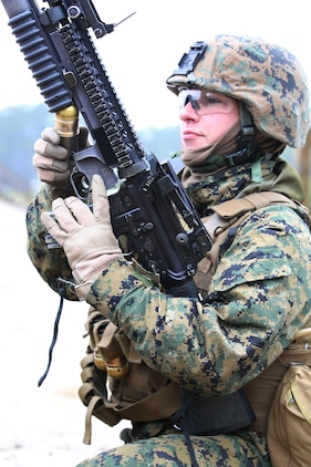 Sgt. Radmila M. Allen, team leader with 3rd Platoon, Company A, Ground Combat Element Integrated Task Force, loads a 40mm grenade into an M203 grenade launcher during a live-fire range at the Verona Loop training area, near Marine Corps Base Camp Lejeune, North Carolina, Jan. 14, 2015. Marines with Co. A conducted live-fire training, squad attacks, and patrolling in preparation for their upcoming assessment at Marine Corps Air Ground Combat Center Twentynine Palms, California. From October 2014 to July 2015, the GCEITF will conduct individual and collective level skills training in designated ground combat arms occupational specialties in order to facilitate the standards based assessment of the physical performance of Marines in a simulated operating environment performing specific ground combat arms tasks. (U.S. Marine Corps photo by Sgt. Alicia R. Leaders/Released)