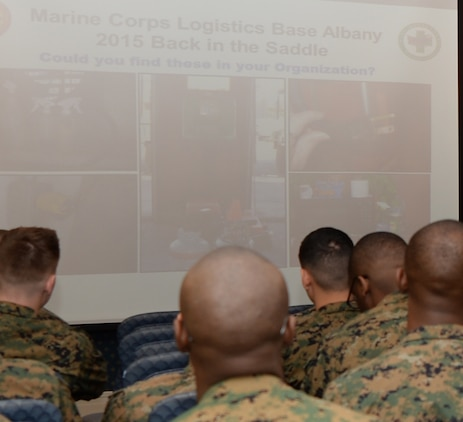 """Slides of safety hazards are shown during """"Back in the Saddle"""" training to Marines at Marine Corps Logistics Base Albany's Conference Center, Jan. 15."""