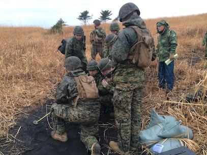 15 January 2015, Fuji Maneuver Area, Gotemba, Japan - 1stLt Downs, 1st Battalion, 1st Marine Regiment, explains 60mm mortar platoon operations to MGEN Togashi, Director, Infantry School, Fuji Schools, Japan Ground Self-Defense Force.