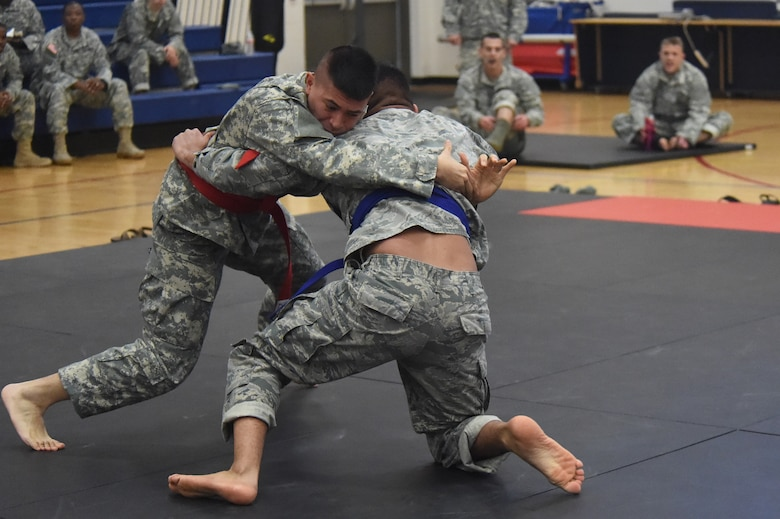 Two U.S. Army 743rd Military Intelligence Battalion Squadron members compete for commander's cup points during a combatives tournament at the Buckley Fitness Center Jan. 15, 2015, on Buckley Air Force Base, Colo. The army battalion hosts the tournament every year to hone hand-to-hand combat training techniques while engaging in friendly competition. (U.S. Air Force photo by Airman 1st Class Samantha Saulsbury/Released)