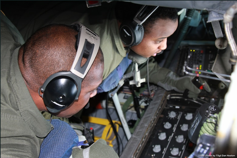 Airman 1st Class Andre McClain, a boom operator with the 171st Air Refueling Squadron, conducts an aerial refueling operation in a KC-135 Stratotanker while under the supervision of Master Sgt. George Hall, Jan. 13, 2014. McClain is a relatively recent addition to the 171st after initially joining the Michigan Air National Guard as a personnel specialist with the 127th Force Support Squadron. (U.S. Air National Guard photo by Tech. Sgt. Dan Heaton)