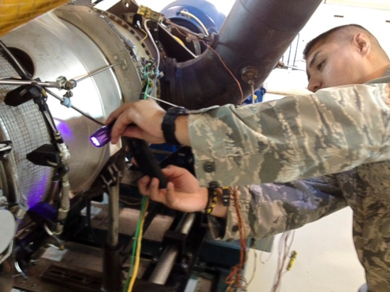 Tech. Sgt. Joseph Salazar, 12th Air Force (Air Forces Southern) Noncommissioned officer in charge of Tactical Aircraft, examines a portion of a PT6A turboprop engine on Dec. 15, 2014 in Miami, Fl. Salazar is a part of a two man team from the aircraft maintenance and munitions branch sent to Florida to gain knowledge on commercial maintenance best practices on the PT6A turboprop engine platform. (Courtesy Photo)