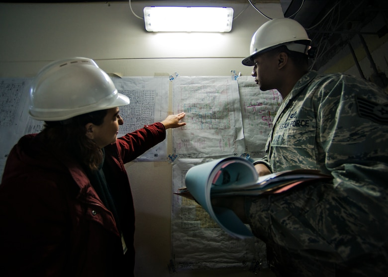 Tech. Sgt. Nicholas Northam, 39th Contracting Squadron NCO in charge of base infrastructure, reviews a blueprint during a site visit Jan. 8, 2015, at Incirlik Air Base, Turkey. The 39th CONS has strict principles and practices that must be followed before presenting any contract. (U.S. Air Force photo by Airman Cory W. Bush/Released)
