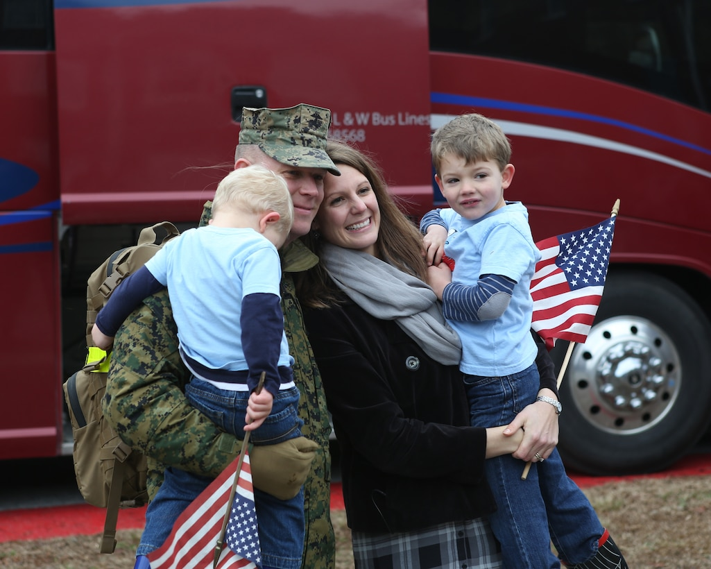 Friends and family members of U.S. Marines with the 26th Marine Expeditionary Unit (MEU) wait for the return of their Marines from deployment at the 26th MEU command post, Camp Lejeune, N.C., Jan. 13, 2015. The Marines were deployed in support of the Special Purpose Marine Air-Ground Task Force Crisis Response-Africa. (U.S. Marine Corps photo by Gunnery Sgt. Andrew D. Pendracki/Released)