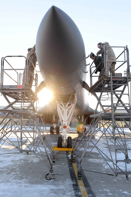 Airmen from the 28th Maintenance Squadron perform maintenance on a B-1 bomber prior to take-off at Ellsworth Air Force Base, S.D., Jan. 7, 2015. Airmen from the 28th MXS work throughout various weather conditions yearlong to keep all B-1s on Ellsworth mission ready. (U.S. Air Force photo by Airman 1st Class Rebecca Imwalle/Released)