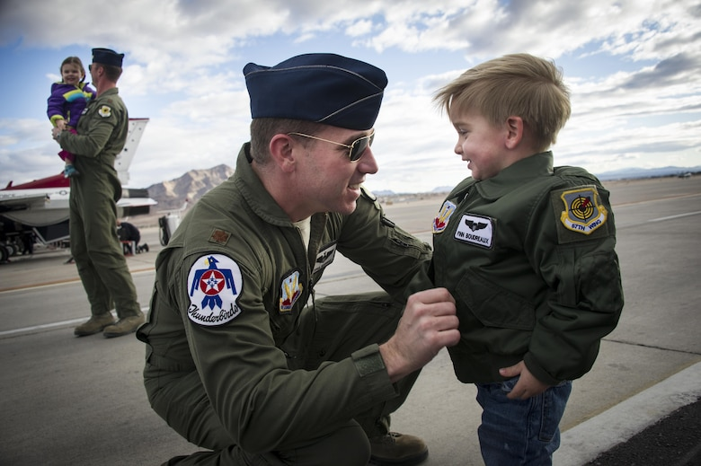 Maj. Joshua Boudreaux, Thunderbird 2, and Maj. Jason Curtis, Thunderbird 5, are greeted by their children after performing their first Delta Formation sortie, Nellis Air Force Base, Nev., Jan. 13, 2015. (U.S. Air Force photo/Tech. Sgt. Manuel J. Martinez)
