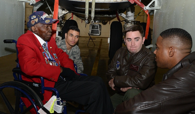 Calvin Spann, a Tuskegee Airman, speaks with Maj. Matthew Millard, right, 11th Bomb Squadron, inside the bomb bay of a B-52H Stratofortress during a visit to Barksdale Air Force Base, La., Dec. 27, 2014. Spann, a Lieutenant in the Army Air Corps, would serve in Italy during World War II, where he was a P-51 Mustang pilot and flew in 26 combat missions. (U.S. Air Force photo/Senior Airman Benjamin Gonsier)
