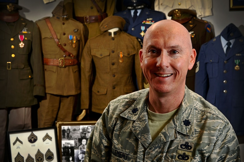 Lt. Col. Kyle Clement stands in front of his vintage U.S. military uniform collection Jan. 9, 2015 at Shaw Air Force Base, S.C.  Collecting for more than 20 years, Clement's goal is to preserve Airman heritage by piecing together authentic uniforms dating back to 1914. Clement is the 20th Maintenance Group deputy commander.  (U.S. Air Force photo/Senior Airman Jensen Stidham)