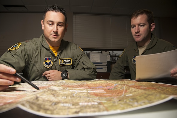 Maj. Kevin Coughlin reviews flight plans before a flight Nov. 20, 2014, at Little Rock Air Force Base, Ark. Coughlin spent time training Israeli aircrews on the Coordinated Aircraft Positioning (CAP) system and Station Keeping Equipment (SKE) formation operation systems. Coughlin is the 48th Airlift Squadron flight commander and an instructor pilot. (U.S. Air Force photo/Senior Airman Kaylee Clark)