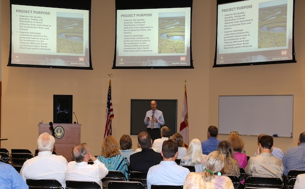 Dr. Brad Foster, Jacksonville District's Planning Technical Lead for the Loxahatchee River Watershed Restoration Project, provides a project overview during the public scoping meeting held Jan. 12 in Stuart, Fla.