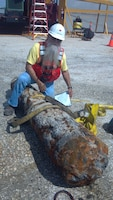 The discovery of an early 18th century cannon during work on the Miami Harbor Deepening Project was certainly an exciting moment for crew members of the Great Lakes Dredge and Dock (GLD&D) LLC Company.