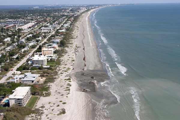 Contractors pump sand onto miles of Brevard County beaches.