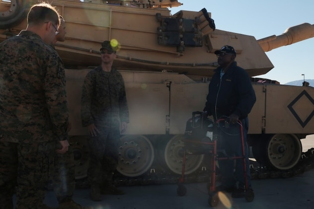 Kenny R. White, Marine veteran, native of San Diego, Calif., passes knowledge to Marines of 1st Tank Battalion on the 1st Tanks Ramp, Dec. 22, 2014. White wanted to be a crewman ever since he was younger, watching the tanks go by on Camp Elliott, Calif. (Official Marine Corps photo by Lance Cpl. Medina Ayala-Lo/Released)