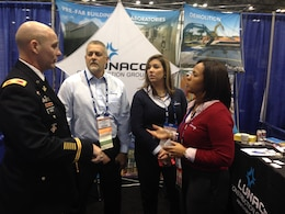 Col. alan Dodd reaches out to attendees at the annual Society of American Military Engineers' 2014 Small Business Conference in Kansas City, Missouri