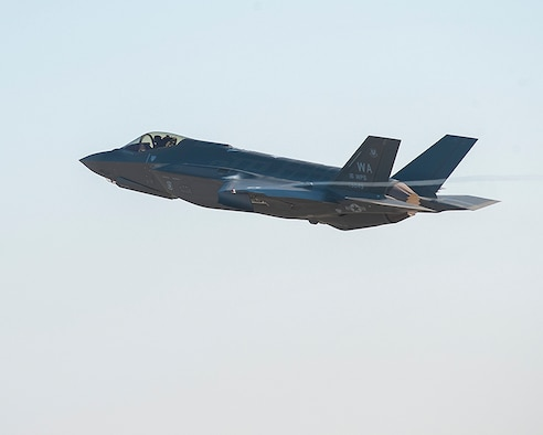 An F-35A Lightning II, piloted by Capt. Brent Golden, launches from the Lockheed Martin plant Jan. 15, 2015, in Fort Worth, Texas. Golden flew the F-35 directly from the Lockheed plant to its new home in at Nellis Air Force Base, Nev. Golden in a 16th Weapons Squadron instructor. (Courtesy photo/Randy Crites, Lockheed Martin)