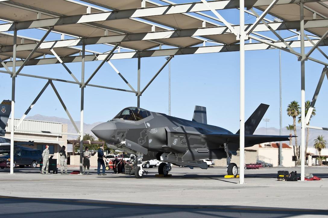 The U.S. Air Force Weapons School's first assigned F-35A Lightning II sits under a sun shade on the flightline Jan. 15, 2015, at Nellis Air Force Base, Nev. Working in conjunction with the U.S. Air Force Warfare Center and 422nd Test and Evaluation Squadron, the USAFWS' first F-35 will be used to drive tactics development. (U.S. Air Force photo/Airman 1st Class Mikaley Towle)