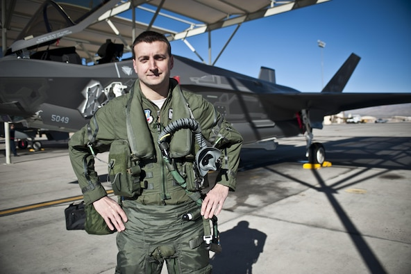 Capt. Brent Golden, 16th Weapons Squadron instructor, poses for a photo in front of the U.S. Air Force Weapons School's first assigned F-35A Lightning II Jan. 15, 2015, at Nellis Air Force Base, Nev. Golden piloted the aircraft from Lockheed Martin's plant in Fort Worth, Texas, to its new home at the USAFWS. (U.S. Air Force photo/Staff Sgt. Siuta B. Ika)