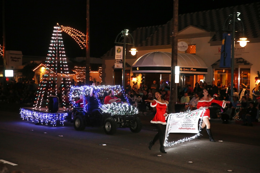 """A float decorated in holiday themed lights rolls down the street playing music form the motion picture """"Frozen"""" at the 23rd annual Festival of Lights Parade in Palm Springs, Calif., Dec. 6, 2014. More than 60,000 people attended the annual parade. (Official Marine Corps Photo by Lance Cpl. Julio McGraw/Released)"""