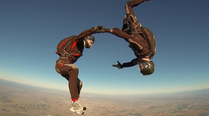 Team EagleBear in their 20th point of their national record-setting skydive. The Two-Way Vertical Formation Skydiving team consists of brothers, Andre Gerner (left), a masters animation student at UCLA and Cadet 2nd Class Joseph Gerner (right), an aeronautical engineering major at the Academy.