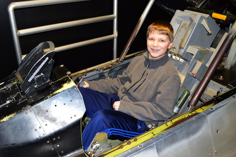 DAYTON, Ohio - A museum visitor enjoying the F-16 Sit-in Cockpit in the Cold War Gallery at the National Museum of the U.S. Air Force. (U.S. Air Force photo)
