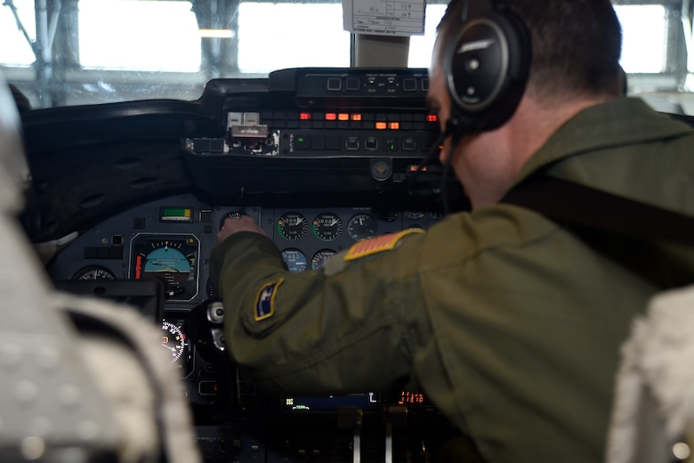 Capt. Jacob Buckman, 457th Airlift Squadron pilot, performs a pre-flight check on the instrument panel of a C-21 at Joint Base Andrews, Md., Jan. 9, 2015. The check allows the crew to ensure the aircraft is safe and ready to fly. (U.S. Air Force photo/Airman 1st Class Ryan J. Sonnier)